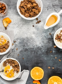 Top view breakfast bowls with granola and fruit