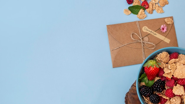Top view of breakfast cereals with envelope