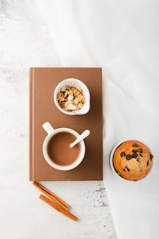 Top view breakfast set with coffee mug on notebook