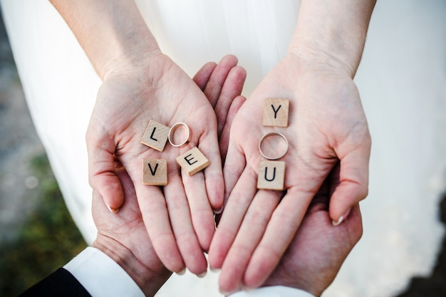 Top view of bride's hands with the wedding rings