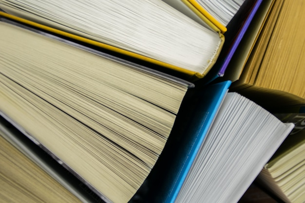 Top view of bright colorful hardback books in a circle. open book, fanned pages.