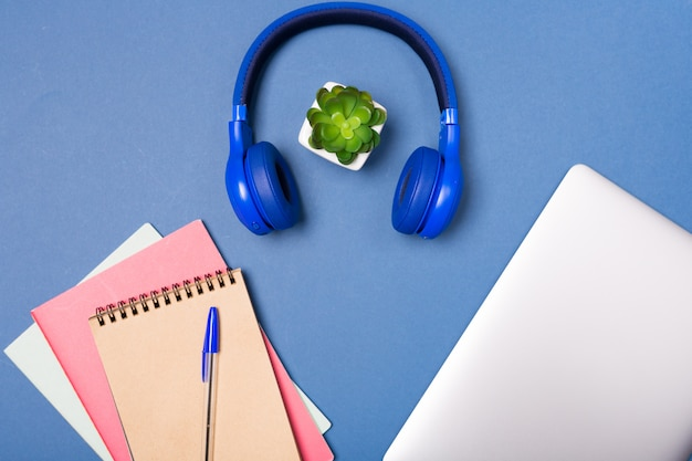 Top view of bright colourful desk top. laptop, notebook, ear phones. work home office. creativity. creative work. freelance. school desk top.
