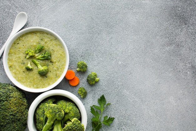 Top view broccoli and carrots bisque with copy space