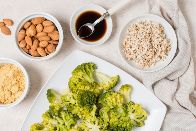 Top view of broccoli on plate with almonds