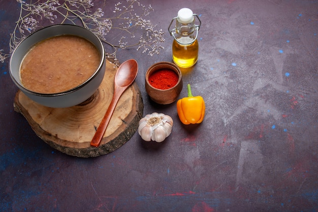 Top view brown bean soup with olive oil and garlic on dark surface soup vegetable meal food kitchen bean