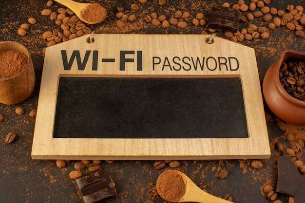 A top view brown coffee seeds with choco bars. wi-fi password board sign