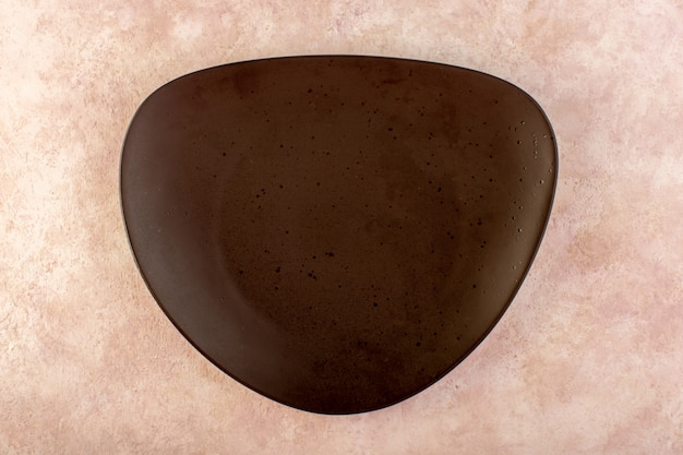 A top view brown designed plate glass made isolated meal table