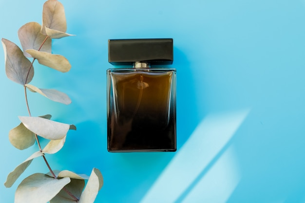 Top view of brown perfume bottle with plant