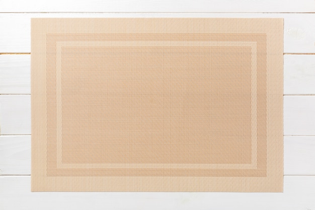 Top view of brown place mat for a dish. wooden background with empty space for your design