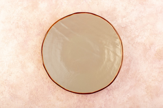 A top view brown round plate empty glass made isolated meal table color