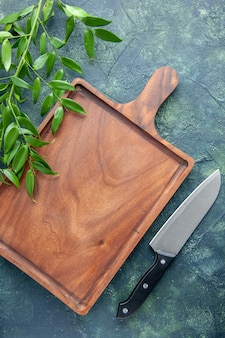 Top view brown wooden desk on a dark blue background knife food color meat kitchen ancient butcher cuisine