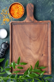 Top view brown wooden desk on dark blue surface ancient cuisine meat butcher kitchen knife food