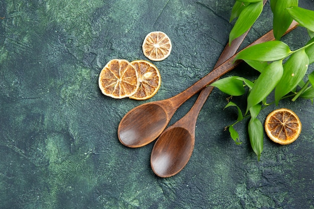 Top view brown wooden spoons on a dark-blue background food kitchen pepper ancient meal cuisine seasoning