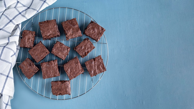 Top view of brownies on cooling rack with copy space