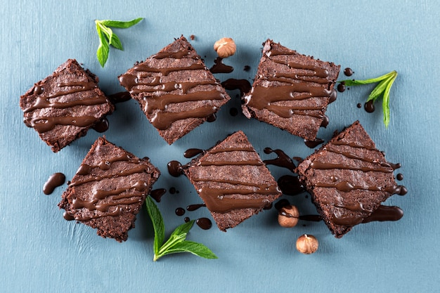 Top view of brownies with hazelnuts and mint