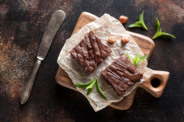 Top view of brownies with mint and hazelnuts