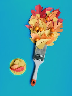 Top view of brush loaded with autumn leaves on blue paper wall