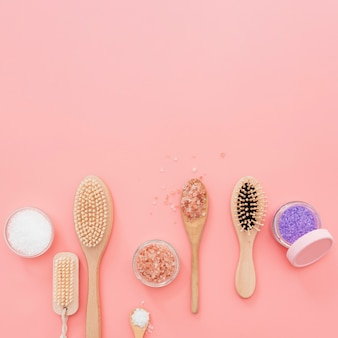 Top view of brushes and bath salts with copy-space