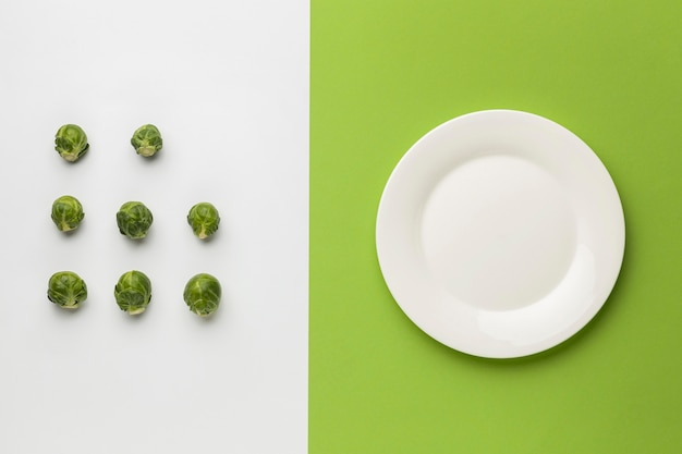 Top view of brussels sprout with plate