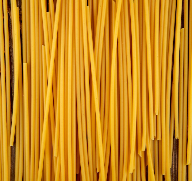 Top view bucatini pasta on wooden background