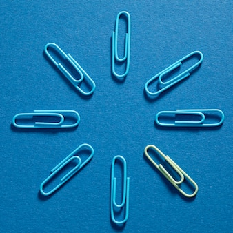 Top view bunch of blue paper clips on the table