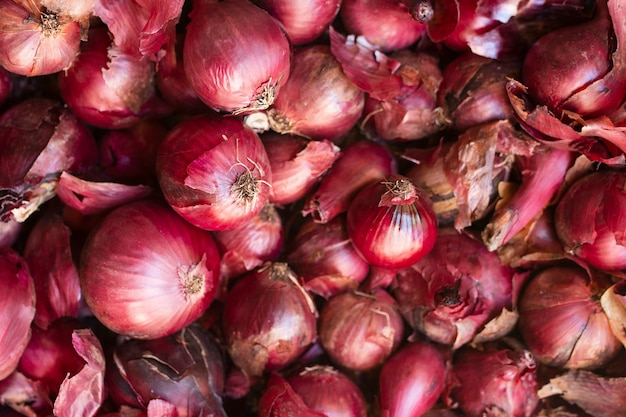Top view bunch of organic red onions