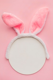 Top view of bunny ears with paper and copy space