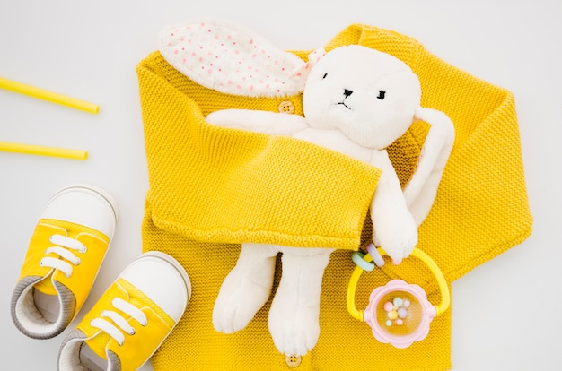 Top view bunny toy with yellow sweater