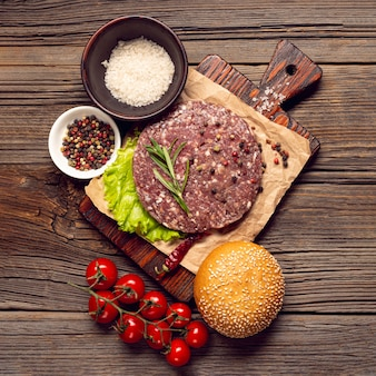 Top view burger ingredients on a cutting board