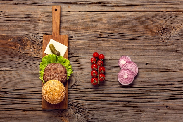 Top view burger ingredients on wooden table