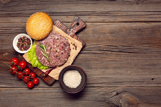 Top view burger ingredients on a wooden table