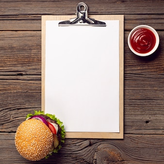 Top view burger with mock-up clipboard