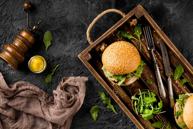 Top view burgers in basket with copy-space and kitchen towel