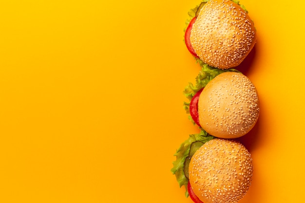 Top view burgers on orange background
