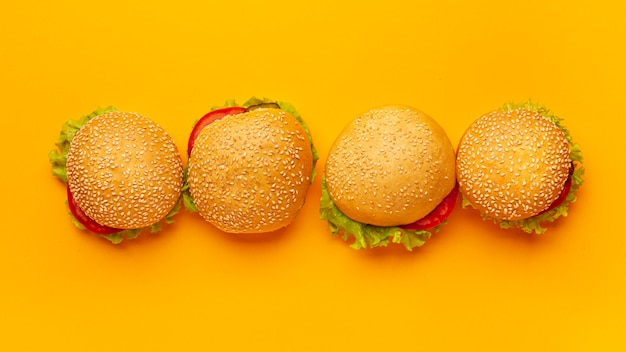 Top view burgers with orange background