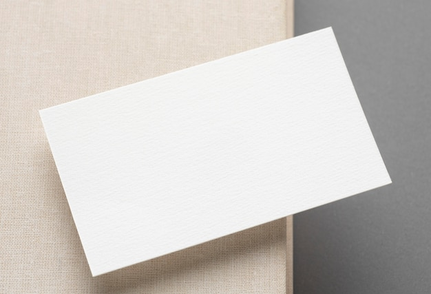 Top view business card on white and grey table