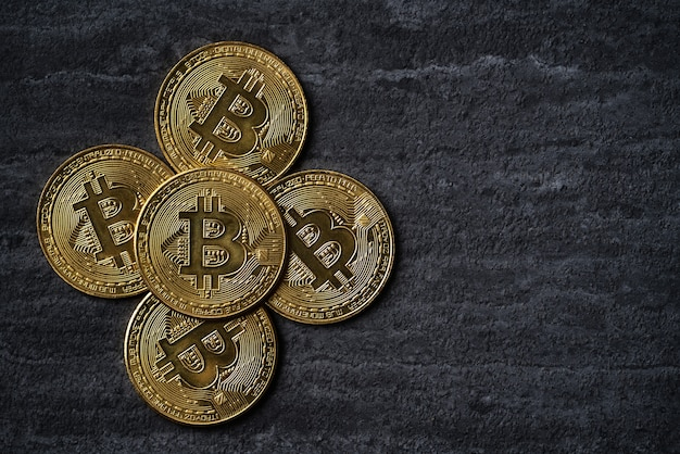 Top view business concept of bitcoin cryptocurrency money on dark black slate table background.