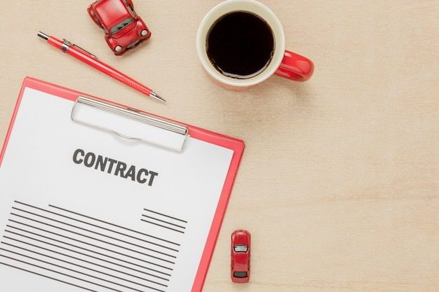 Top view business contract form  with  on wooden background.