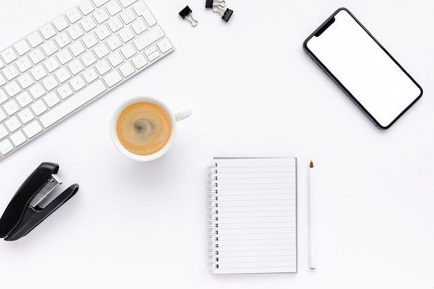 Top view business desk arrangement on white background