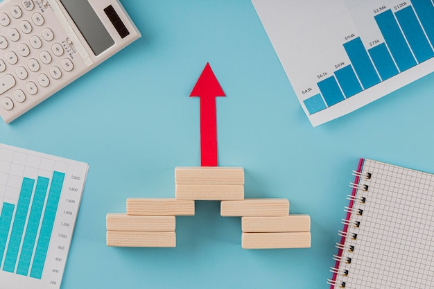 Top view of business items with growth chart and arrow