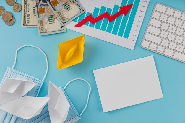 Top view of business items with growth chart and banknotes