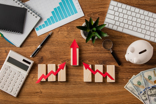 Top view of business items with growth chart and wooden cubes