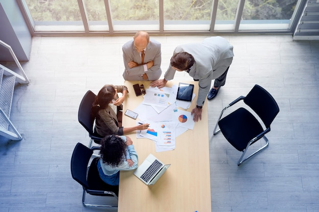 Top view of business people are meeting in office , business teamwork concept .