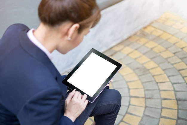 Top view of business woman is holding tablet with blank copy space screen