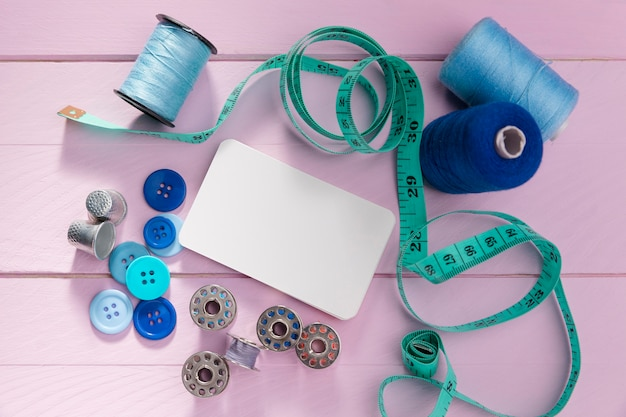 Top view of buttons with measuring tape thread reels