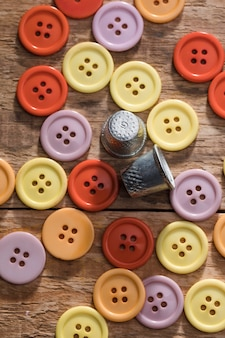 Top view of buttons with thimbles on wooden surface