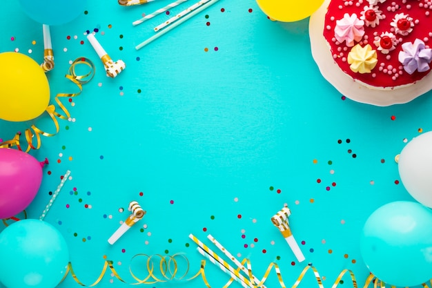 Top view of cake and balloons