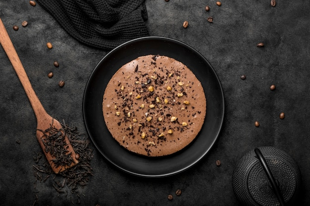 Top view of cake on plate with spatula and coffee beans