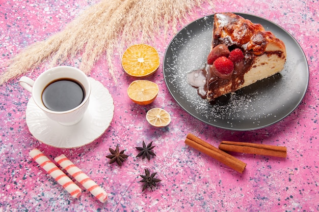 Top view cake slice with chocolate and red strawberries cup of tea on pink desk biscuit sweet sugar dessert cake bake