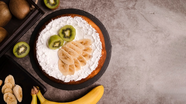 Top view of cake with banana slices and copy space